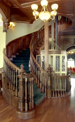 A luxurious traditional wood balustrade with rich detail.