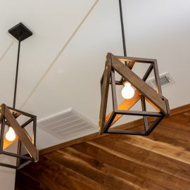 Two Modern Wooden Chandeliers on Ceiling
